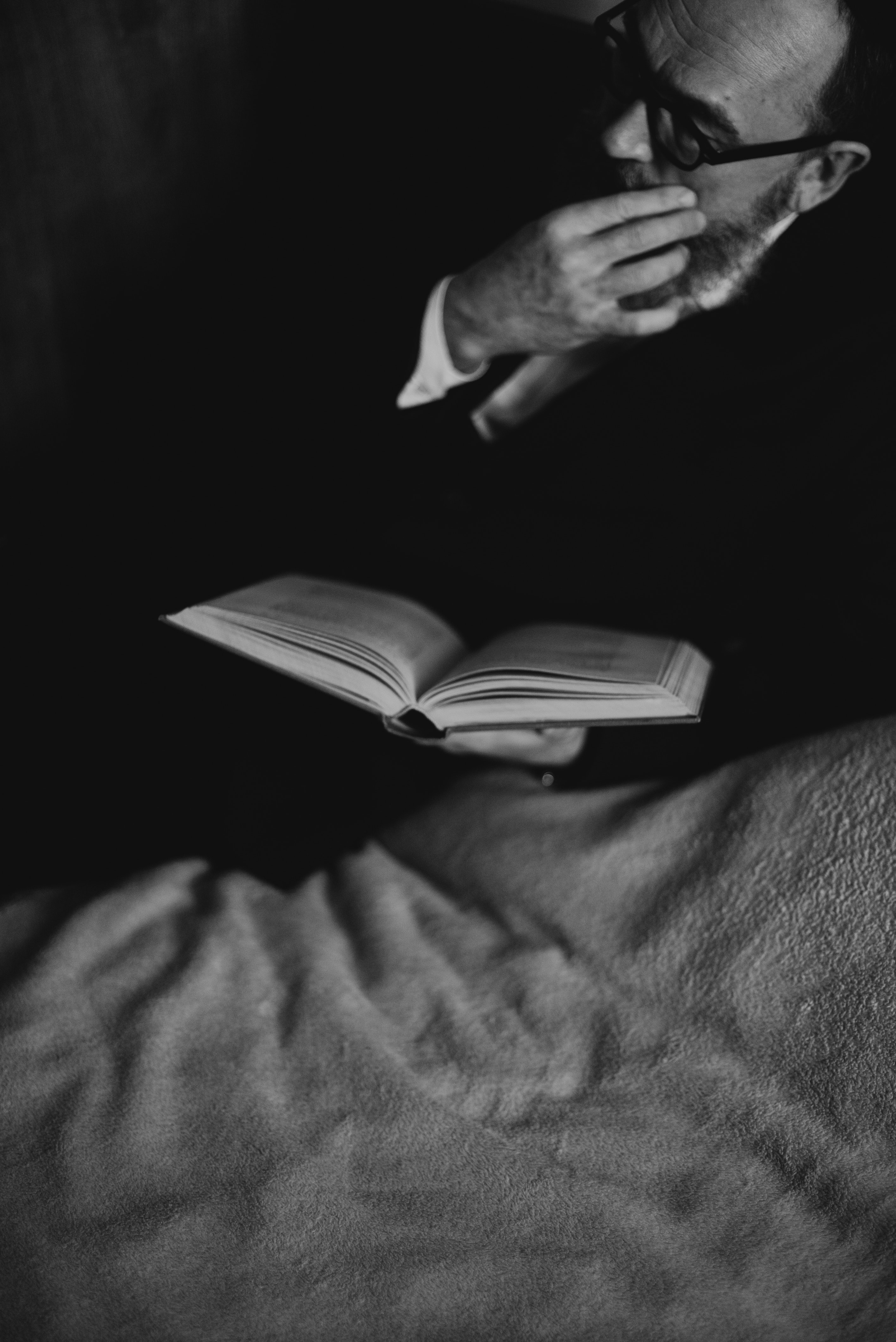 bearded-man-holding-a-book-4033948